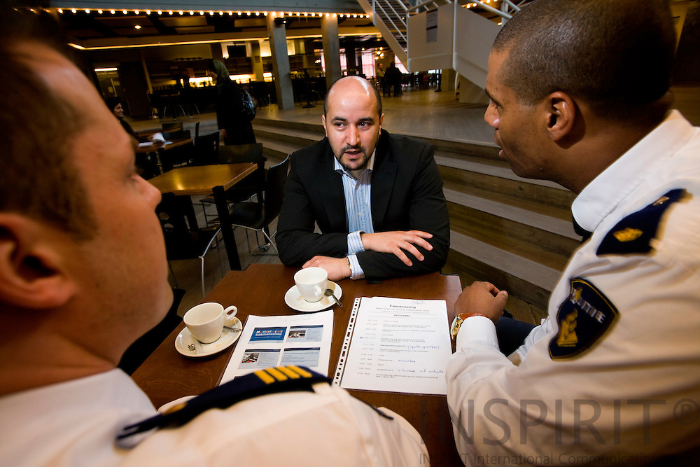 AMSTERDAM - NETHERLANDS - 06 MARCH 2008 -- Ahmed MARCOUCH, mayor of the Amsterdam district of Slotervaart, speaking with Alfred C. van DIJK (Le) and D. HOUKES (Ri), both police officers at the Dutch police force. Photo: Erik Luntang