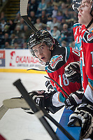 KELOWNA, CANADA - OCTOBER 7:  Tate Coughlin #18 of Kelowna Rockets stands on the bench against the Swift Current Broncoson October 7, 2014 at Prospera Place in Kelowna, British Columbia, Canada.  (Photo by Marissa Baecker/Getty Images)  *** Local Caption *** Tate Coughlin;