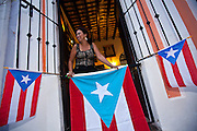 A woman watches the parade of the Festival of San Sebastian in San Juan, Puerto Rico.