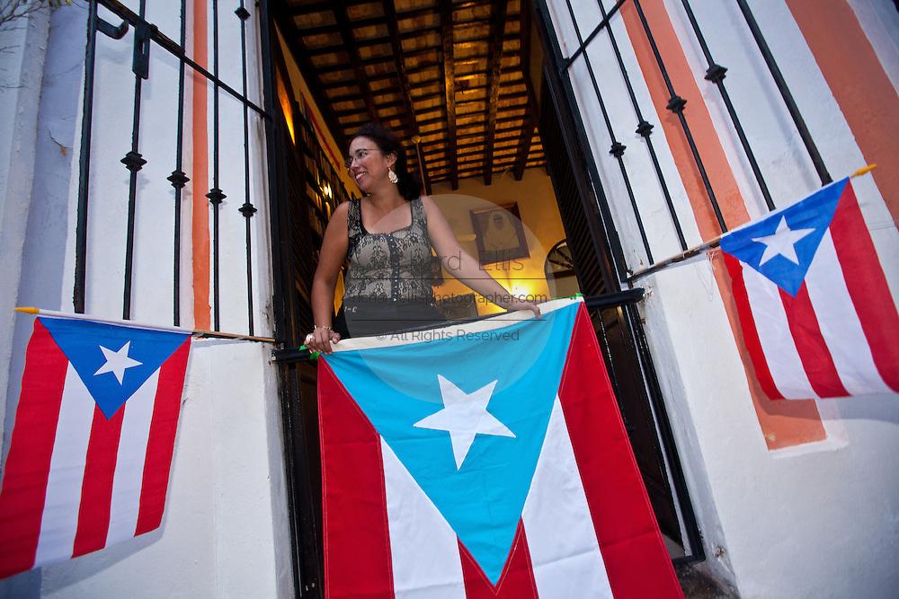 A woman watches the parade of the Festival of San Sebastian in San Juan, Puerto Rico.