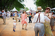 Party goers swinging on the dance floor at Governor's Island