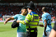 Sergio Aguero (10) of Manchester City is prevented from celebrating with the crowd by a police officer after Raheem Sterling (7) of Manchester City winning goalduring the Premier League match between Bournemouth and Manchester City at the Vitality Stadium, Bournemouth, England on 26 August 2017. Photo by Graham Hunt.