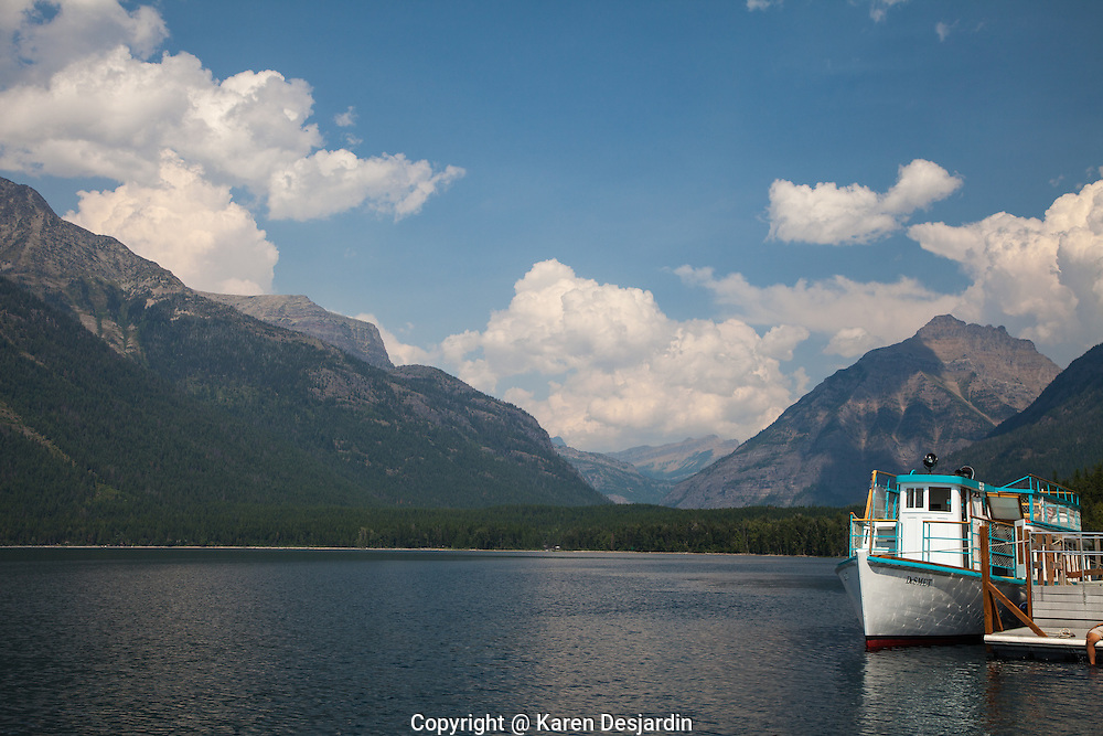 An historic wooden excursion boat waits at a dock on Lake McDonald in Glacier National Park, Montana. http://www.gettyimages.com/detail/photo/excursion-boat-at-dock-glacier-national-park-royalty-free-image/182986717
