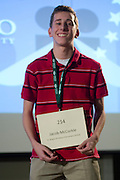 Jacob McCorkle of St. Brigid Of Kildare Elementary School introduces himself during the Columbus Metro Regional Spelling Bee Regional Saturday, March 16, 2013. The Regional Spelling Bee was sponsored by Ohio University's Scripps College of Communication and held in Margaret M. Walter Hall on OU's main campus.
