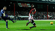Allan McGregor of Hull City and Marco Djuricin of Brentford during the Sky Bet Championship match between Brentford and Hull City at Griffin Park, London<br /> Picture by Mark D Fuller/Focus Images Ltd +44 7774 216216<br /> 03/11/2015