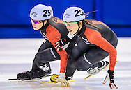 Valerie Maltais (250) and Marianne St-Gelais fight for position in the women's 1500m A final at the Speed Skating Canada Fall World Short Track Selections at the Olympic Oval in Calgary, Alberta on September 19, 2014.