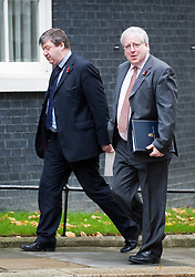 © London News Pictures. 01/11/2011. London, UK. Deputy Chief Whip to the House of Commons Alistair Carmichael (left) and  Conservative Chief Whip Patrick McLoughlin (right) arriving at 10 Downing Street this morning (01/11/2011) for a cabinet meeting. Photo credit: Ben Cawthra/LNP