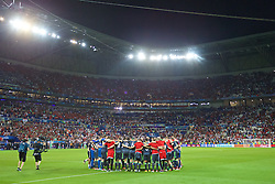 LYON, FRANCE - Wednesday, July 6, 2016: Wales players form a team huddle after the 2-0 defeat to Portugal during the UEFA Euro 2016 Championship Semi-Final match at the Stade de Lyon. (Pic by David Rawcliffe/Propaganda)