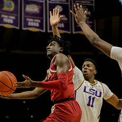Jan 8, 2019; Baton Rouge, LA, USA; Alabama Crimson Tide guard Kira Lewis Jr. (2) shoots over LSU Tigers forward Kavell Bigby-Williams (11) and forward Naz Reid (0) during the first half at the Maravich Assembly Center. Mandatory Credit: Derick E. Hingle-USA TODAY Sports