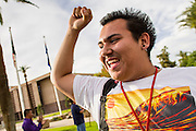 23 APRIL 2012 - PHOENIX, AZ:    DAMIAN CUEVAS, a high school student, chants while he marches to the Arizona State Capitol Monday. About 200 high school students from across the Phoenix metropolitan area rallied at the Arizona state capitol in Phoenix Monday to show their opposition to Arizona's tough anti-immigration law, SB 1070. April 23 is the 2nd anniversary of the law's signing. The US Supreme Court is taking up the law during a hearing Wednesday, April 25 in Washington DC.        PHOTO BY JACK KURTZ
