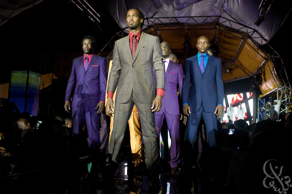 """Male models showcase the outfits of famed designer Ozwald Boateng during the July 13, 2008 leg of the ThisDay music and fashion festival in Lagos, Nigeria. The festival, themed """"Africa Rising"""", aims to raise awareness of African issues while promoting positive images of Africa using music, fashion and culture in a series of concerts and events in Nigeria, the United States and the United Kingdom. ."""