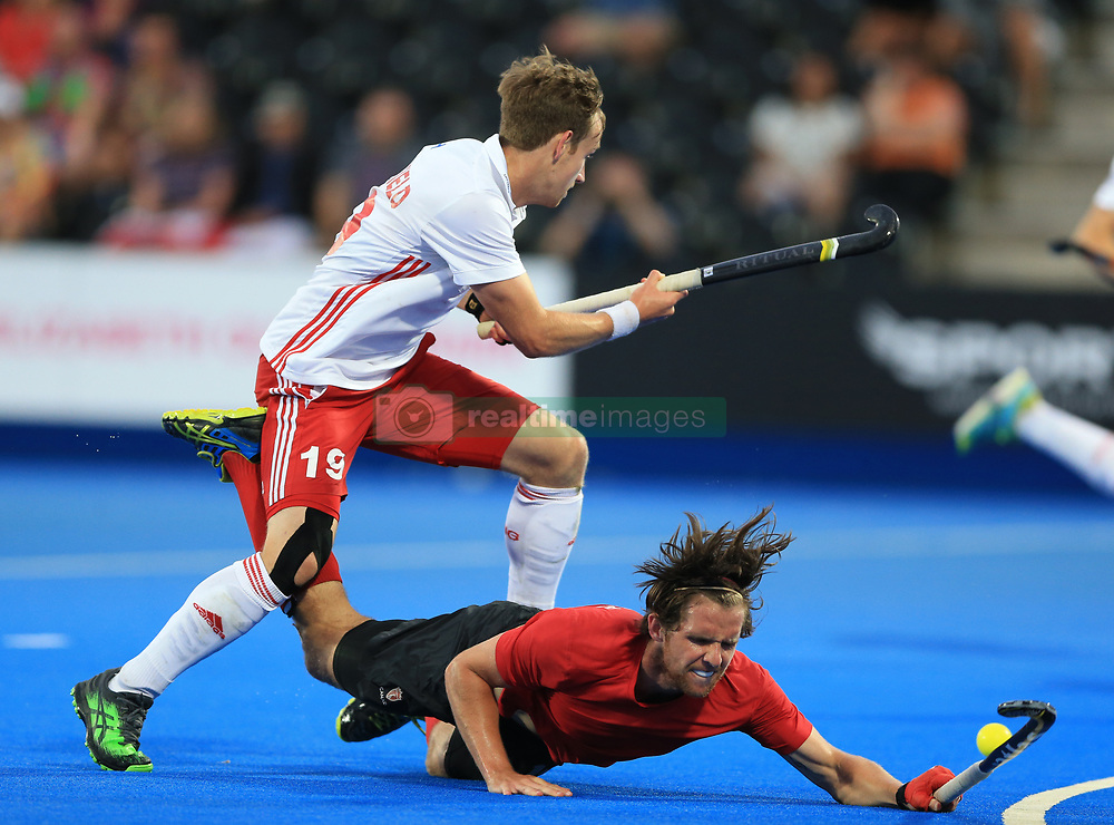 England's David Goodfield (left) and Canada's Adam Froese battle for the ball during the Men's World Hockey League match at Lee Valley Hockey Centre, London.
