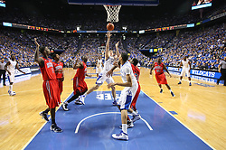 UK forward Kyle Wiltjer, center, puts up an awkward basket in the first half. UK hosted Ole Miss Saturday, Feb. 18, 2012 at Rupp Arena in Lexington . Photo by