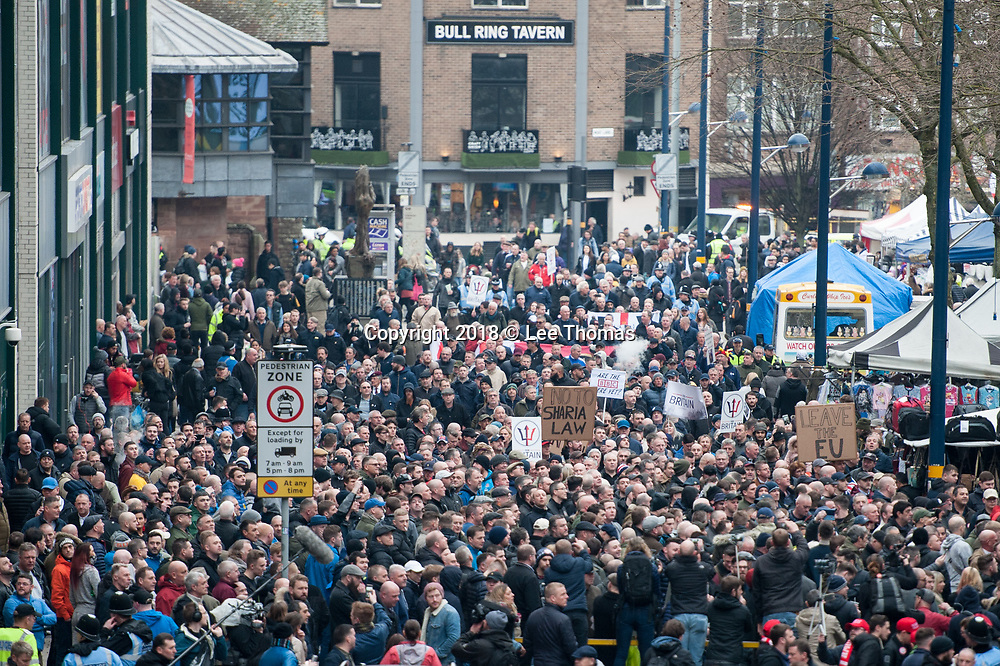 Birmingham, West Midlands, UK. 24th March 2018. Thousands of demonstrators converge on Birmingham city centre organised by three individual groups: Football Lads Alliance (FLA), Democratic Football Lads Alliance (DFLA) and Stand Up To Racism.  Pictured: The FLA march ends next to the open market near the Bullring. // Lee Thomas, Tel. 07784142973. Email: leepthomas@gmail.com  www.leept.co.uk (0000635435)