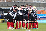 Grimsby Town huddle prior to the EFL Sky Bet League 2 match between Grimsby Town FC and Port Vale at Blundell Park, Grimsby, United Kingdom on 10 March 2018. Picture by Mick Atkins.