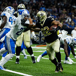 Oct 15, 2017; New Orleans, LA, USA; New Orleans Saints running back Mark Ingram (22) stiff arms Detroit Lions free safety Glover Quin (27) on a touchdown run during the first half of a game at the Mercedes-Benz Superdome. Mandatory Credit: Derick E. Hingle-USA TODAY Sports