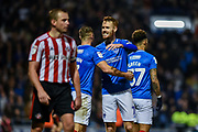 Portsmouth Midfielder, Tom Naylor (7) all smiles and celebrating at the final whistle during the EFL Sky Bet League 1 match between Portsmouth and Sunderland at Fratton Park, Portsmouth, England on 22 December 2018.