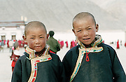 In front of the Main Assembly Hall, two young boys  are waiting with their father the beginning of the ceremony of the afternoon, in the tibetan monastery of Labrang. It was founded in 1709 and belongs to the Gelugpa order, also called Yellow Hats. Xiahe, China, February 22, 2007.....[French] En face du Grand Hall d'Assemblée (Tsogkang) deux jeunes garçons tibétains accompagnés de leur père attendent le début des cérémonies de l'après-midi au monastère de Labrang. Fondé en 1709 il appartient à l'ordre Gelugpa, communément appelé ordre des Bonnets Jaunes. Xiahe, Chine, 22 Février 2007.