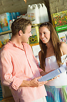 Happy Couple Buying Plant Food