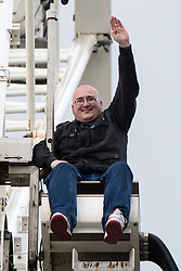 © Licensed to London News Pictures . FILE PICTURE DATED 06/05/2014 of DOMENYK NOONAN (also known as Dominic Lattlay-Fottfoy and Dominic Noonan ) climbing the big wheel in Manchester City Centre . Today Noonan has been handed an 11 year sentence after being convicted of several historical sexual assaults on young boys . Photo credit : Joel Goodman/LNP