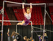 Brehanna Showers performing on the bars during the Sooners vs Georgia Gymnastics Meeting on Friday evening, January 11, 2019 at the Lloyd Noble Center