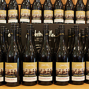 Bottles of wine for sale at the cellar door at The Gibbston Valley vineyard in Gibbston Valley, Central Otago. The winery includes a cave which has been blasted out of the solid schist of the Central Otago mountains, and creates an ideal natural environment to mature award-winning wines, Gibbston Valley Wines,  Queenstown, Central Otago, New Zealand. 23rd March  2011. Photo Tim Clayton.