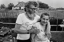 A couple Petr Gavrilov (69) and Zinaida Abramova (65) residents of the house for an old released prisoners in a village Blagoveshenka, Kemerovo region, Eastern Siberia, Russia, 16 August 1995. Blagoveshensky house for an old former prisoners a special institution which is a part of a penitentiary system where live former prisoners which have age more then 55 years after released and haven't house or an apartment and relatives. Petr Gavrilov (69) and Zinaida Abramova (65) more then 60 years on they two lived in prisons for different crimes. They met here after released and started leave together in small separate building with dovecote on the roof.