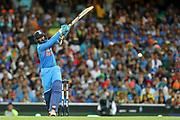 Dinesh Karthik hits through mid-wicket. T20 international, Australia v India. Sydney Cricket Ground, NSW, Australia, 25 November 2018. Copyright Image: David Neilson / www.photosport.nz