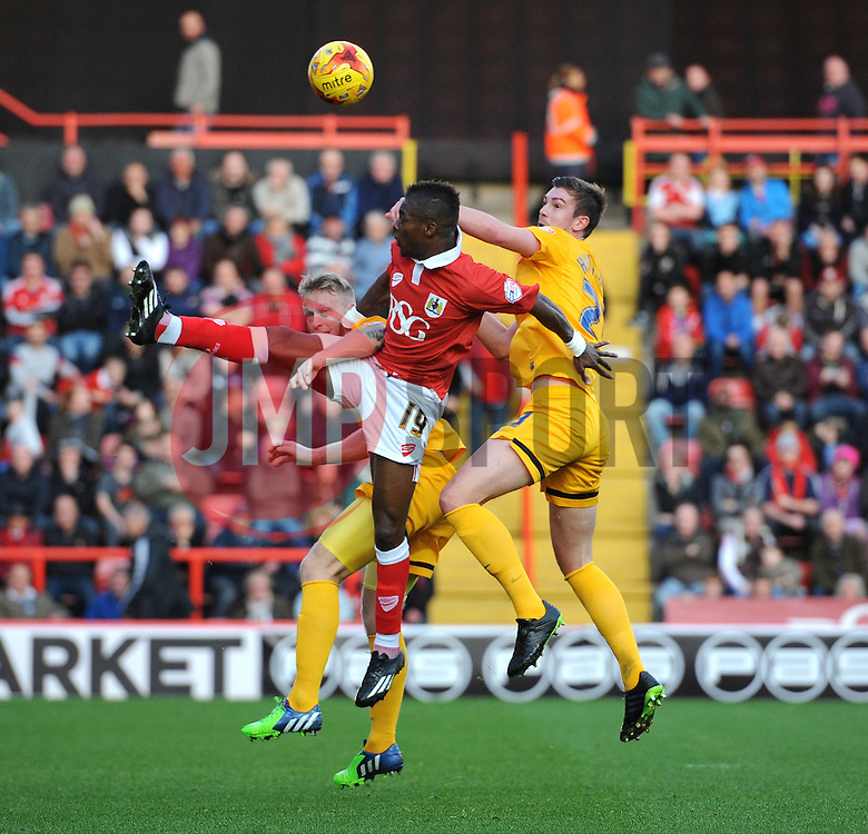 Bristol City's Kieran Agard challenges Preston North End's Keith Keane for the header - Photo mandatory by-line: Dougie Allward/JMP - Mobile: 07966 386802 - 22/11/2014 - Sport - Football - Bristol - Ashton Gate - Bristol City v Preston North End - Sky Bet League One