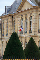 The French tri-color national flag flies outside the Paris Military School in Paris, France.