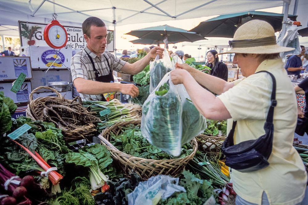 SAN FRANCISCO, CALIFORNIA - Ferry Plaza Farmers Market, shoppers and organic produce