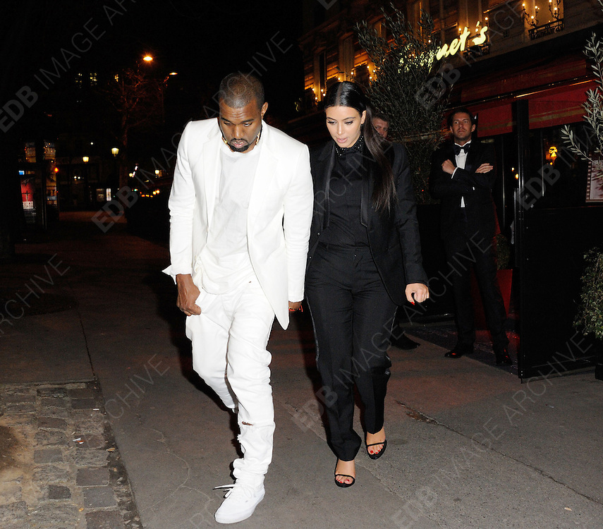 03.MARCH.2013. PARIS<br /> <br /> KIM KARDASHIAN AND KANYE WEST LEAVING GIVENCHY'S DINER HELD IN FOUQUET'S RESTAURANT IN PARIS<br /> <br /> BYLINE: EDBIMAGEARCHIVE.CO.UK<br /> <br /> *THIS IMAGE IS STRICTLY FOR UK NEWSPAPERS AND MAGAZINES ONLY*<br /> *FOR WORLD WIDE SALES AND WEB USE PLEASE CONTACT EDBIMAGEARCHIVE - 0208 954 5968*