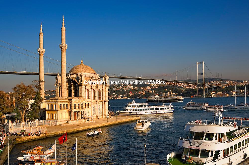Mecidiye Ortakoy mosque and Bosphorus Strait. In background  Bosphorus Bridge (Bogazici bridge). At Ortaköy district.  Istanbul. Turkey