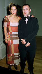 Controversial artist DAMIEN HIRST and MS.MAIA NORMAN at a dinner in London on 1st July 1997.LZW 53