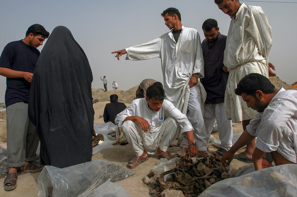 A mass grave thought to contain 10 to 15 thousand victims of Saddam Hussein's regime is uncovered 20 kms north of the town of Hilla.  <br /> Mahwheel, Iraq. 15/05/2003.