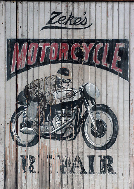An old motorcycle repair sign, Napa California, USA.A larger file of this image may be available