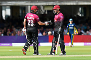 James Hildreth of Somerset and Peter Trego of Somerset touch gloves during the Royal London 1 Day Cup Final match between Somerset County Cricket Club and Hampshire County Cricket Club at Lord's Cricket Ground, St John's Wood, United Kingdom on 25 May 2019.