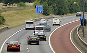 © Licensed to London News Pictures. 16/07/2012. London, UK Traffic on the M4 motorway near an Olympic lane on July 16, 2012 which opened today. Journeys for Olympic officials and athletes into central London are intended to be eased by the Olympic lane on the M4 motorway and surrounding routes from Heathrow airport. Photo credit : Stephen Simpson/LNP
