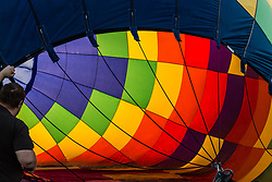 September 7, 2017 - Reno, Nevada, U.S - A crew member holds the edge of a hot air balloon while it is inflated during The Great Reno Balloon Race Preview Day Launch, at Rancho San Rafael Regional Park just north of downtown Reno, Nevada, on Thursday, September 7, 2017 (Credit Image: © Tracy Barbutes via ZUMA Wire)