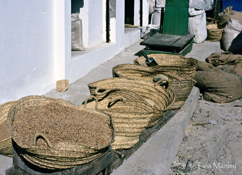 AFRICA, MOROCCO, TANGIER:  Straw baskets of grains and seeds for sale in Berber market in old Tangier.