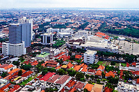 Java, East Java, Surabaya. View over Surabaya center. Surabaya Mall center front of image.  Madura in the background (from helicopter).