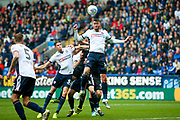 Bolton Wanderers striker Gary Madine (14) clears the danger from a corner during the EFL Sky Bet Championship match between Bolton Wanderers and Leeds United at the Macron Stadium, Bolton, England on 6 August 2017. Photo by Simon Davies.