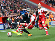 Roger Johnson 2 footed tackle on Matt Ritchie. Trying to stop Bournemouth who were attacking at will  during the Sky Bet Championship match between Charlton Athletic and Bournemouth at The Valley, London, England on 2 May 2015. Photo by Matthew Redman.