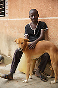 A boy and his dog in Katiola, Cote d'Ivoire on Friday July 12, 2013.