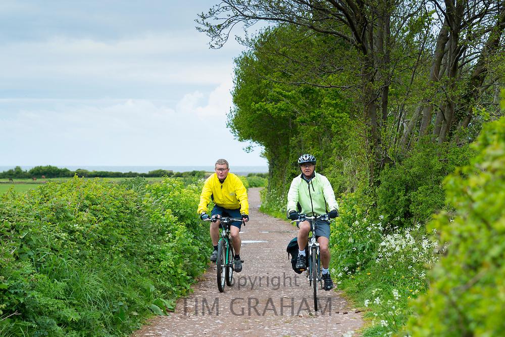 Cyclists by Bossington Beach in Exmoor, Somerset, United Kingdom