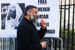 Regent's Park Mosque, London, February 27th 2015. A small group of Islamic Radicals demonstrate after Friday prayers, calling for the release of Islamist Sheikh Omar Bakri Muhammad from prison in Lebanon's Roumeih prison. They say he is unwell and has suffered torture. PICTURED: Anjem Choudary talks to the press.