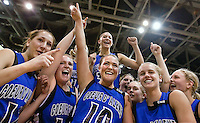Coeur d'Alene High's Whitney Heleker is rides high on the shoulders of her teammates after hitting the game winning three pointer and a free throw to secure the Viking's 54-50 win with 1.7 seconds left in overtime.