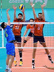 Niels Klapwijk #14, Bas van Bemmelen #8, Mitja Gasparini during volleyball match between National teams of Netherlands and Slovenia in Playoff of 2015 CEV Volleyball European Championship - Men, on October 13, 2015 in Arena Armeec, Sofia, Bulgaria. Photo by Ronald Hoogendoorn / Sportida