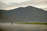 A fisherman at the legendary Lugu Hu Lake in Sichuan Province, southwestern China.