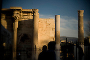 People walk past the Library of Hadrian located near Monastiraki square.Image © Angelos Giotopoulos/Falcon Photo Agency